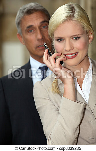 Young woman smiling with mobile phone in hand - csp8839235