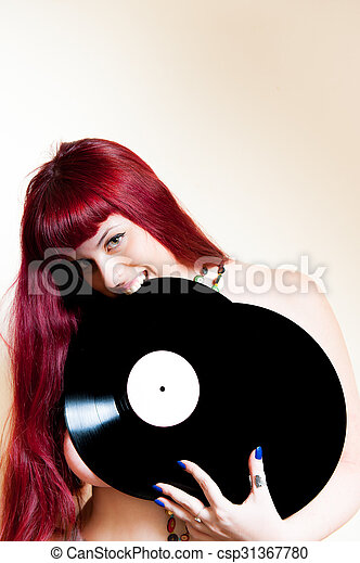 Young woman smiling with vinyl records - csp31367780