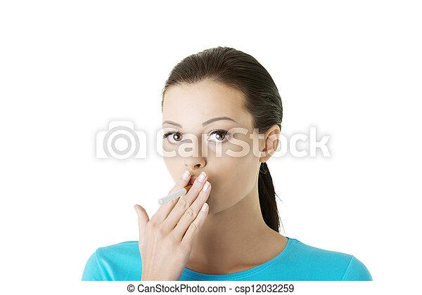 Young woman smoking electronic cigarette (ecigarette) - csp12032259