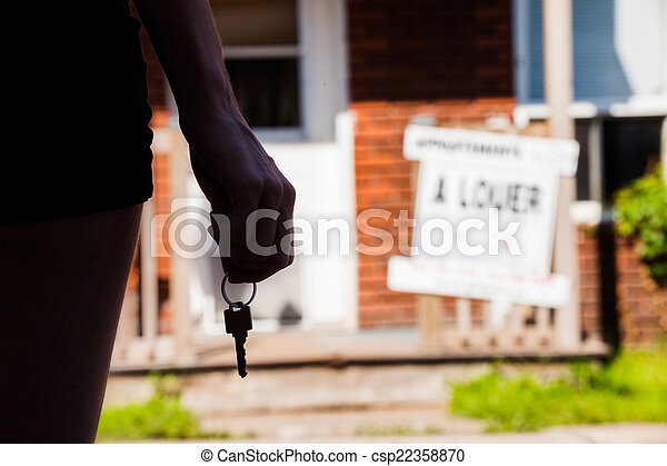 Young Woman standing in front of her new apartment - csp22358870