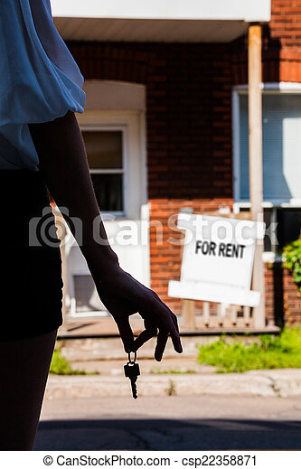 Young Woman standing in front of her new apartment - csp22358871