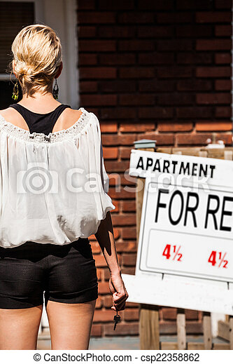 Young Woman standing in front of her new apartment - csp22358862