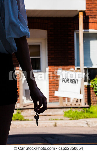 Young Woman standing in front of her new apartment - csp22358854