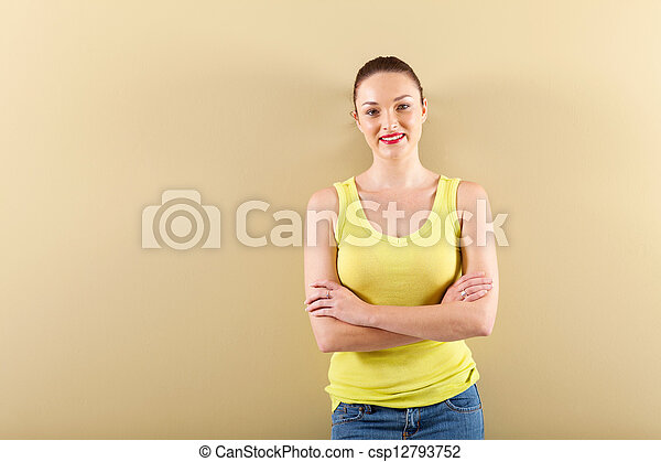 young woman standing in front of wall - csp12793752