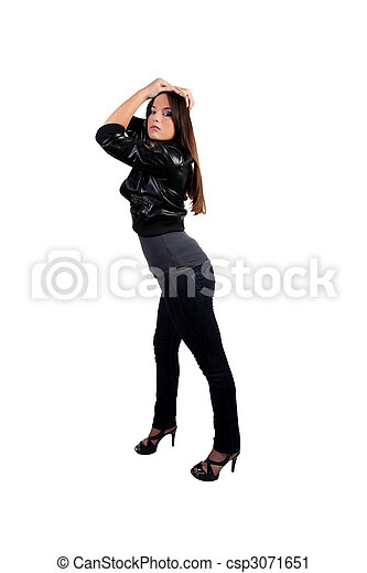 Young woman standing in jeans and heels - csp3071651