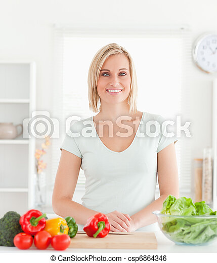 Young woman standing in kitchen - csp6864346