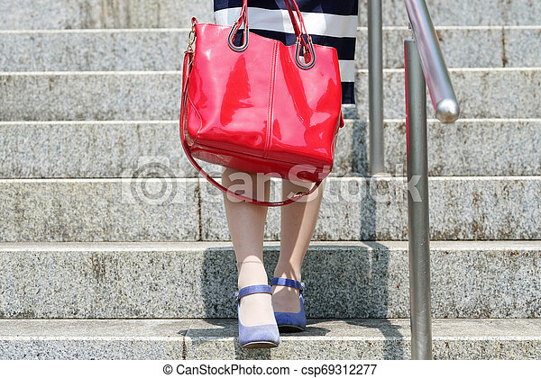Young woman standing on the stairs - csp69312277