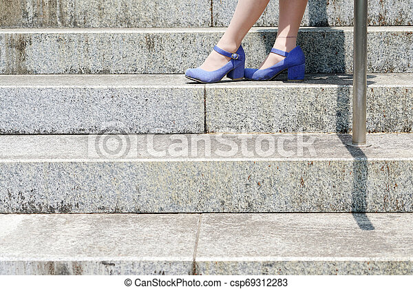 Young woman standing on the stairs - csp69312283