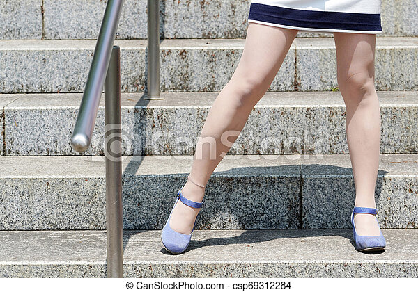 Young woman standing on the stairs - csp69312284