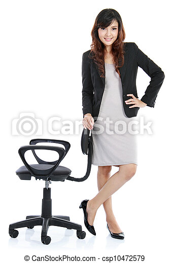 young woman standing with a chair - csp10472579