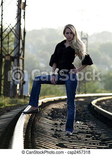 Young woman staying on railway - csp2457318