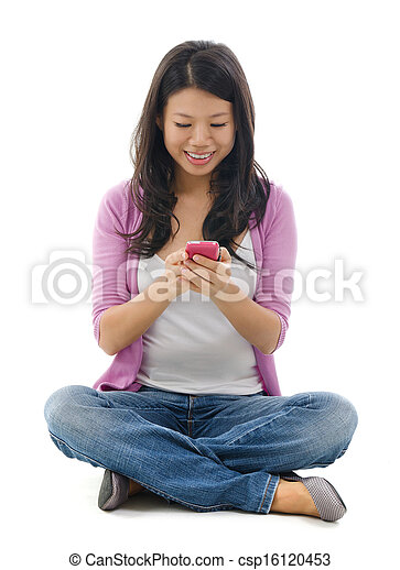 Young Woman texting on smart phone - csp16120453