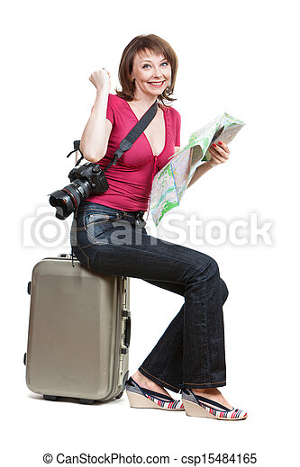 young woman tourist sitiing on the suitcase - csp15484165