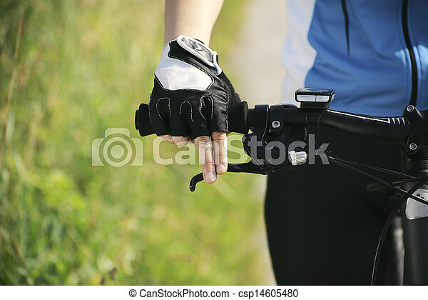young woman training on mountain bike and cycling in park - csp14605480