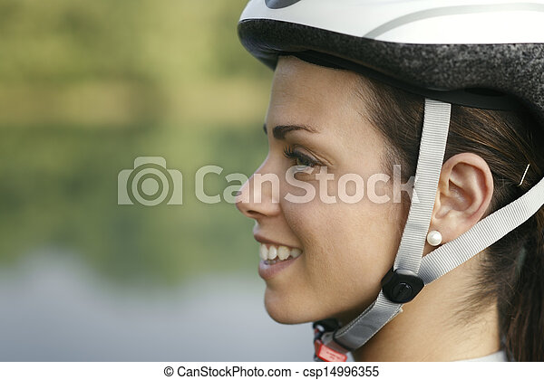 young woman training on mountain bike and cycling in park - csp14996355