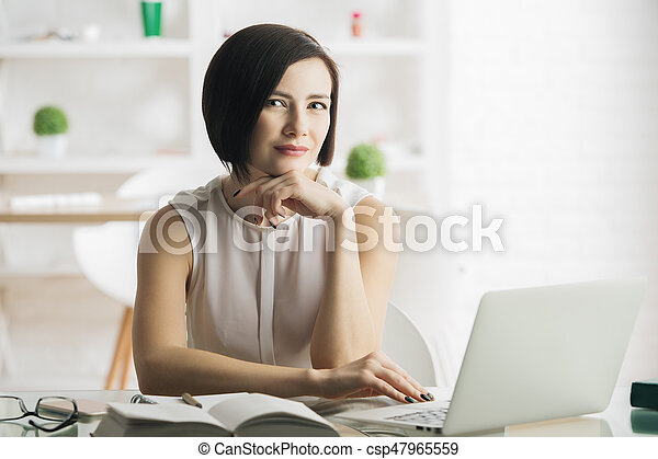 Young woman using laptop - csp47965559