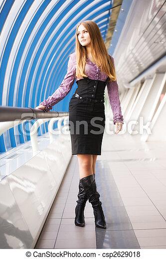 Young woman walking on modern bridge - csp2629018