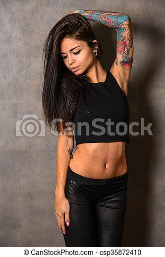 6d316ee4ede1e Young woman wearing black t-shirt. Young woman wearing black ...