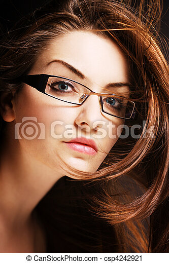 Young woman wearing glasses - csp4242921