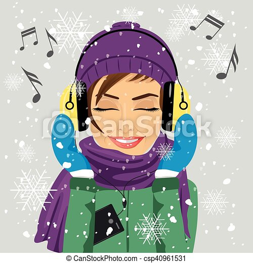 Young woman wearing winter clothes listening to music with young woman wearing winter clothes listening to music with headphones in winter under snowfall vector voltagebd Images