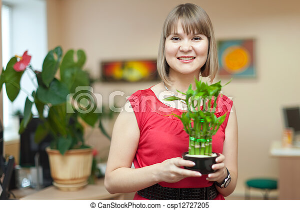 Young woman with bamboo plant   - csp12727205