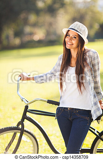 young woman with bicycle - csp14358709