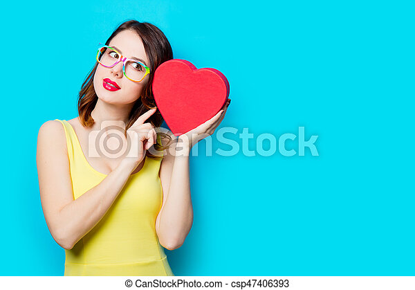 young woman with box - csp47406393