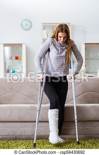 Young woman with broken leg at home.