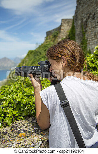 Young woman with camera - csp21192164