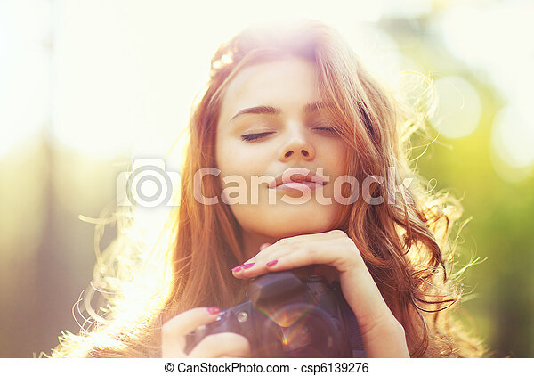 Young woman with camera - csp6139276