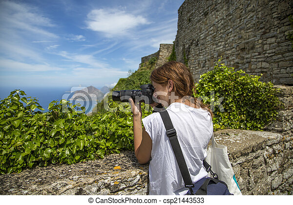 Young woman with camera - csp21443533
