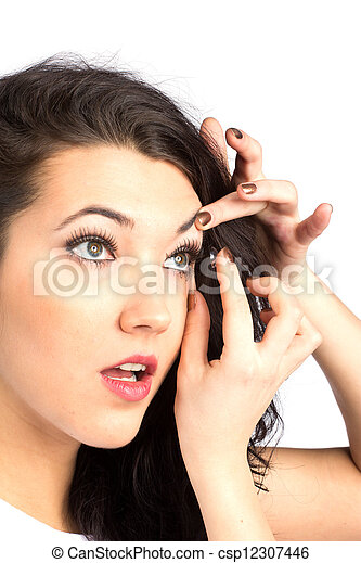 Young woman with contact lense - csp12307446