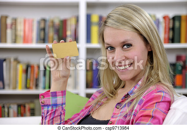 young woman with credit card smiling - csp9713984