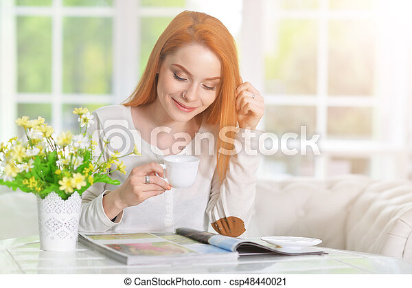 young woman with cup of coffee - csp48440021
