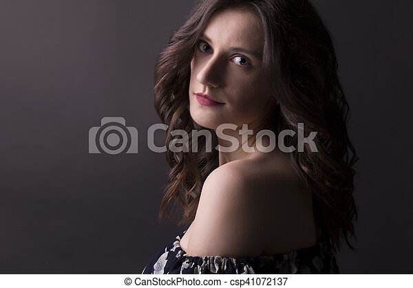 Young woman with curly hair closeup - csp41072137