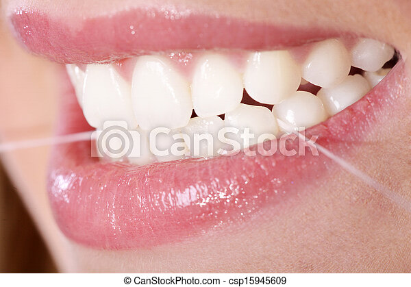 young woman with dental floss - csp15945609