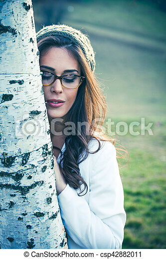 young woman with eyeglasses outdoor portrait - csp42882011