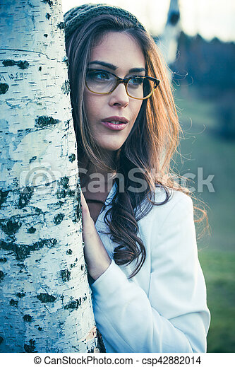 young woman with eyeglasses outdoor portrait - csp42882014