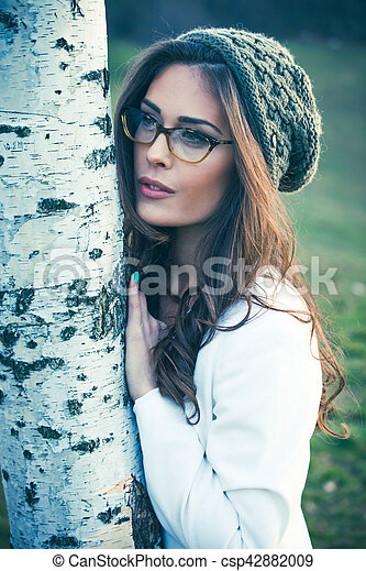 young woman with eyeglasses outdoor portrait - csp42882009