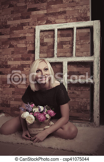Young woman with flowers. Studio shot - csp41075044