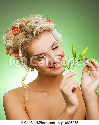 Young woman with green plant. Isolated on whte - csp10608065