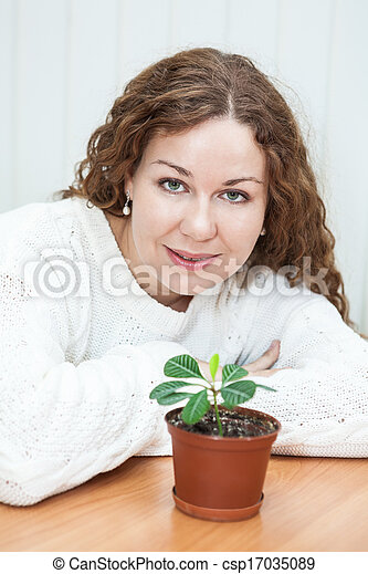 Young woman with green plant - csp17035089