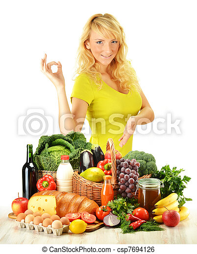 Young woman with groceries isolated on white - csp7694126