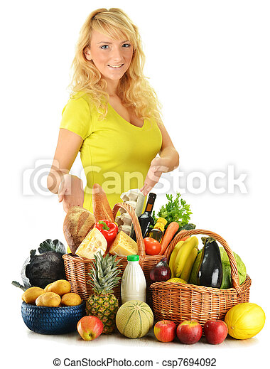 Young woman with groceries isolated on white - csp7694092