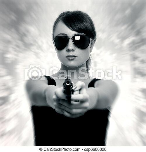 Young woman with gun - csp6686828