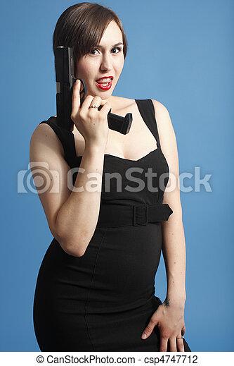 Young woman with gun - csp4747712