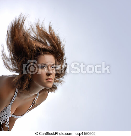 young woman with hair in motion - csp4150609