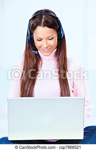 young woman with headphones and  laptop - csp7866521