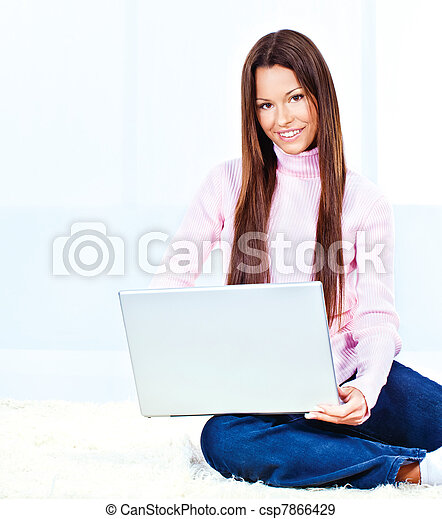 young woman with laptop - csp7866429