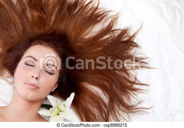 Young woman with long hair. - csp8886215